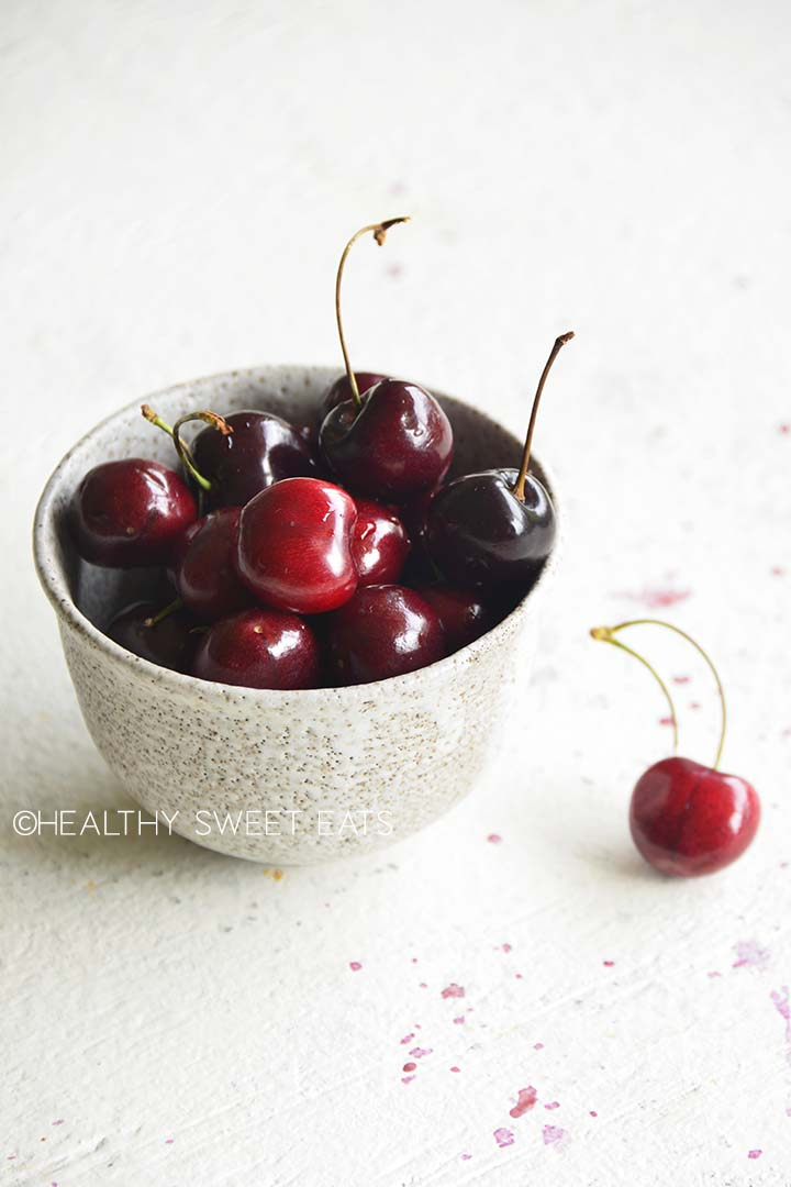fresh cherries in ceramic bowl
