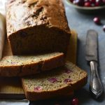Paleo Cranberry Orange Bread Sliced on Bread Board