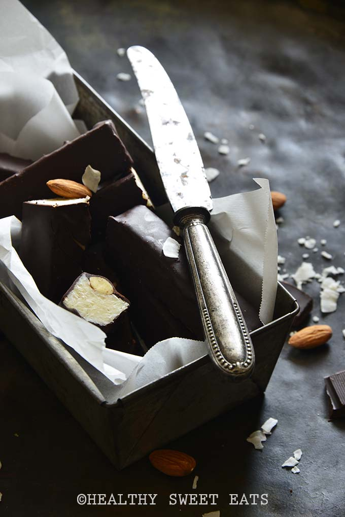 Dramatic and Moody Shot of Keto Homemade Almond Joy Candy Bars on Metal Tray