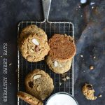 Soft and Chewy Paleo Cinnamon Raisin Noatmeal Cookies on Wire Rack with Milk Glass