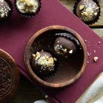 Low Carb Samoa Cookie Truffles in Wooden Dish on Red Book