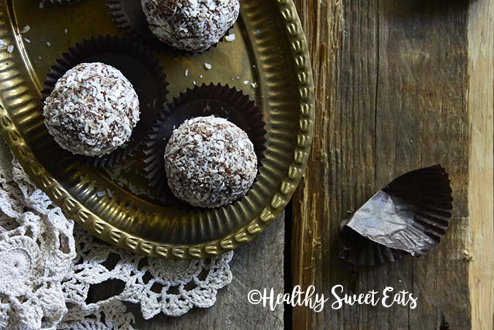 Close Up Overhead View of Low Carb Chocolate Rum Balls (Small Batch; Gluten Free) on Wooden Table