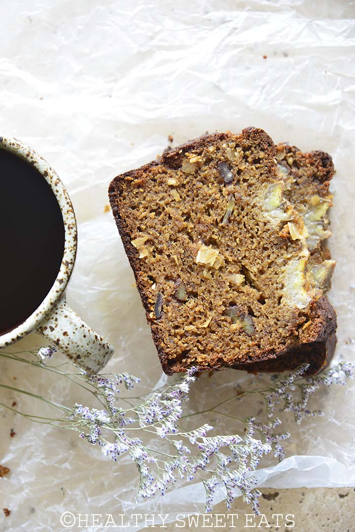 Stack of 2 Slices of Coconut Rum Paleo Banana Bread with Mug of Coffee on Wax Paper