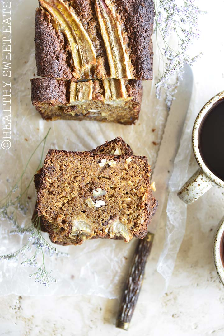 Overhead View of Coconut Rum Paleo Banana Bread with Knife and Coffee Cups