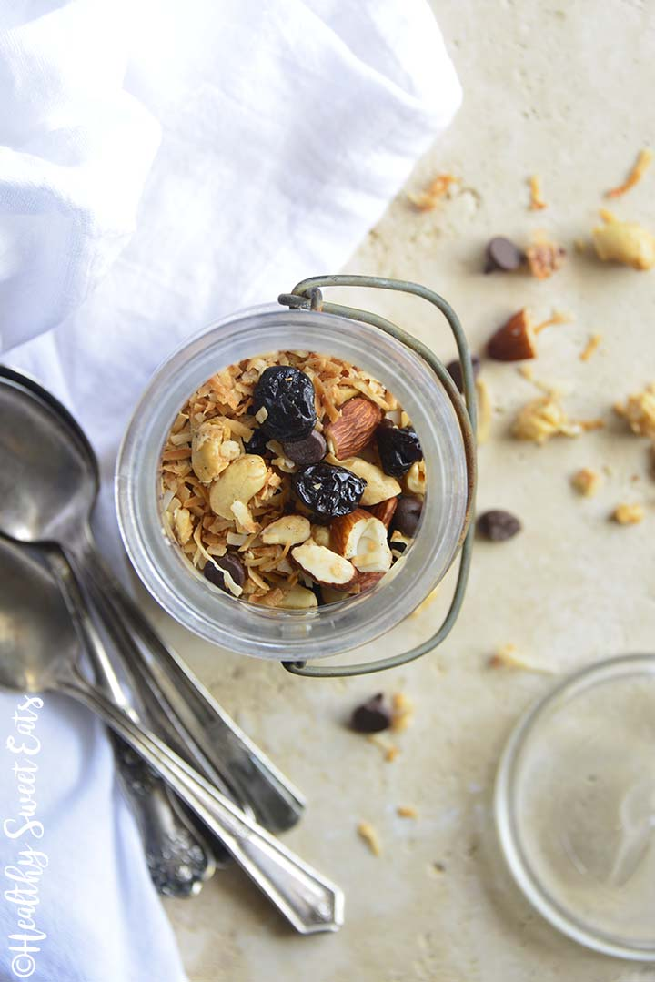 Top View of Grain Free Granola with Cherries, Coconut, and Chocolate Chips in Glass Jar