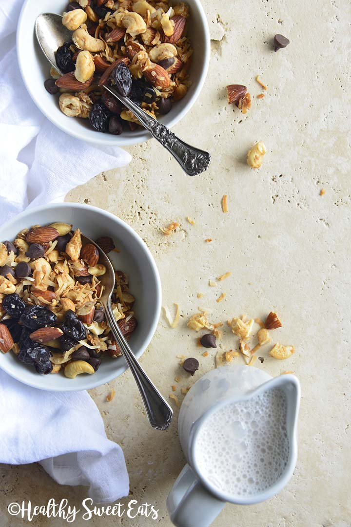 2 Bowls of Grain Free Granola with Jug of Milk and White Linen on Creamy Colored Marble counter