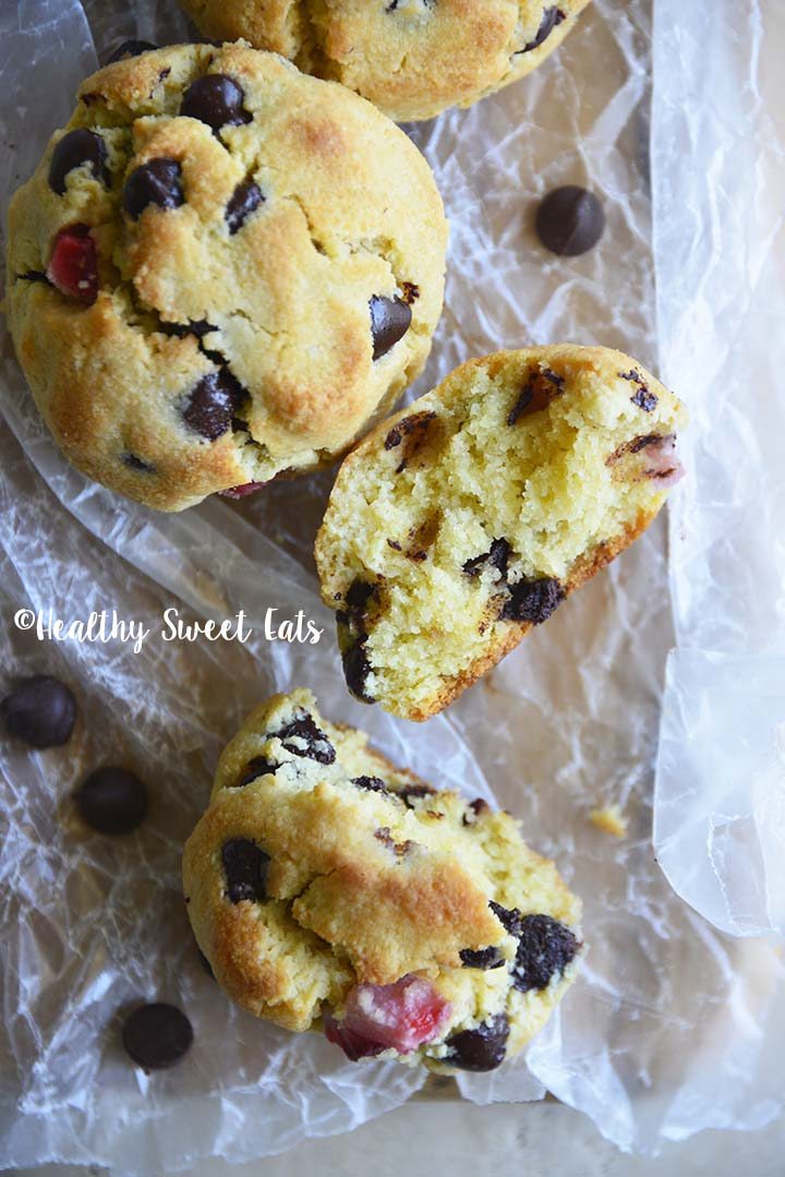 Overhead View of Keto Scones with Strawberries and Chocolate on Crinkled Wax Paper Showing Scone Interior Texture