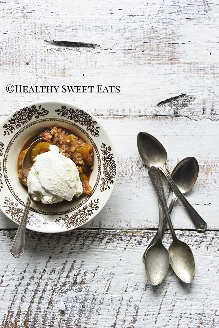 Keto Apple Crisp with Vintage Spoons on White Wooden Table