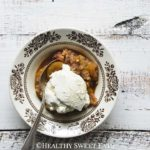 Single Bowl of Faux Apple Crisp Topped with Low Carb Ice Cream on Wooden Table