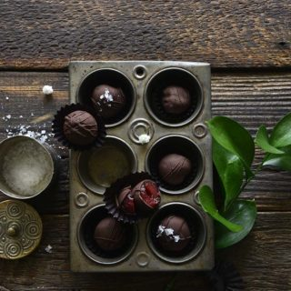 Chocolate Covered Cherries in Vintage Pan with One Cherry Cut Open to Show Inside