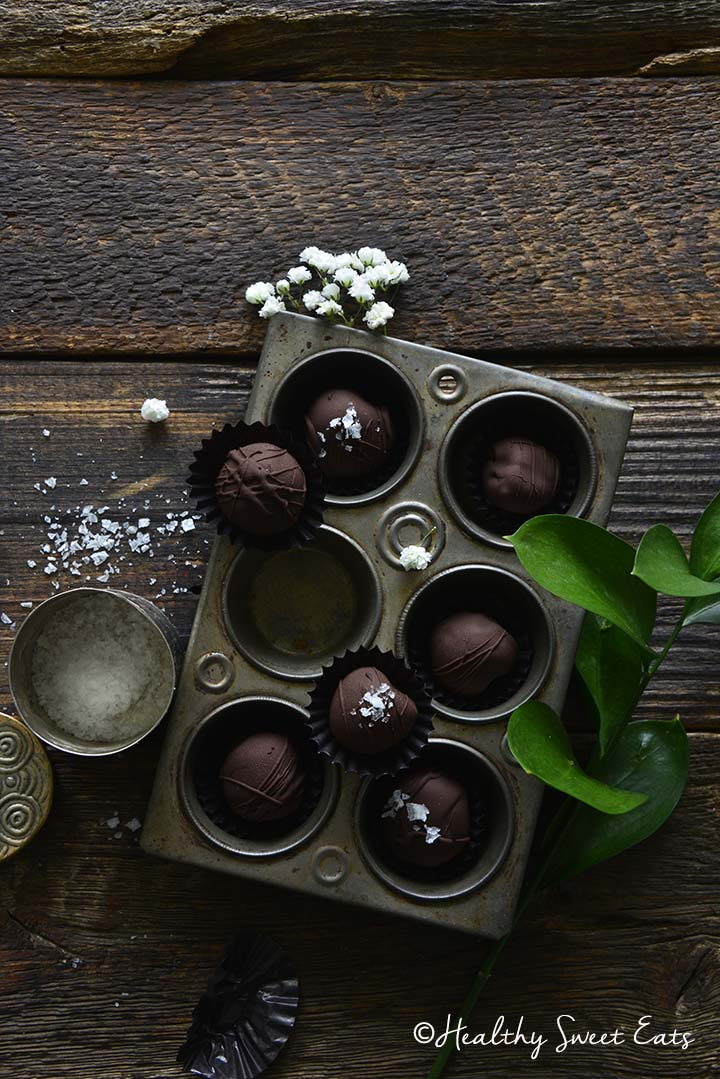 Chocolate Covered Cherries in Vintage Metal Tray on Dark Wooden Table