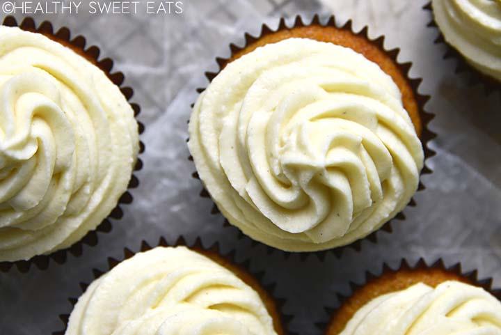 top view of swirls of vanilla buttercream frosting on keto vanilla cupcakes